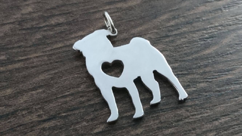 Pug dog with heart silhouette pendant sterling silver handmade by saw piercing Caroline Howlett Design